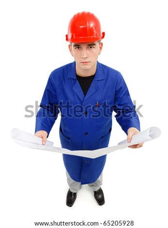 Young construction engineer looking up while holding project - stock photo