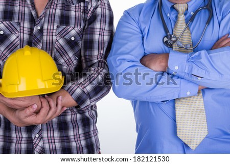 Young construction worker and a doctor isolated on a  white background - stock photo