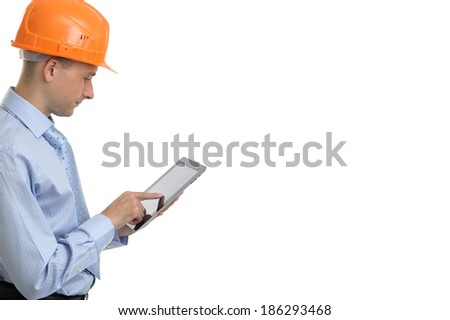 Young construction worker with digital tablet. Isolated - stock photo