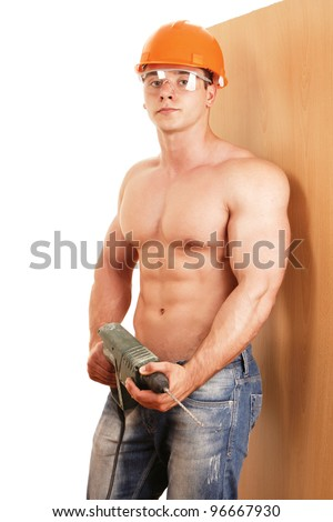 Young constructor at work  with drill - stock photo