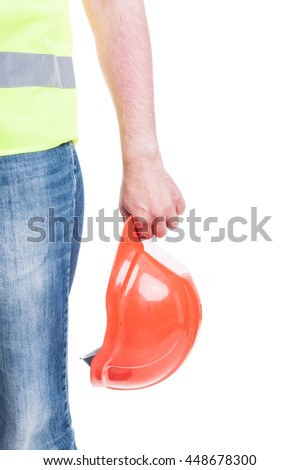Young construtor hand holding a safety hardhat as work equipment isolated on white background - stock photo
