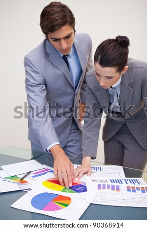 Young consultant and customer looking at statistics
