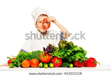 Young cook having fun with fresh vegetables - stock photo