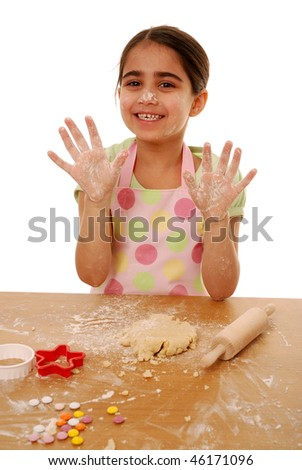 Young cook with hands covered in flour