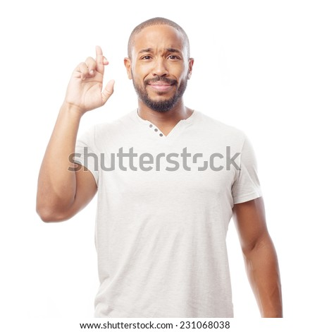 young cool black man finger crossed - stock photo