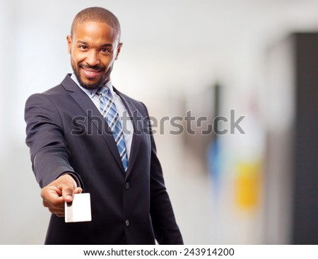 young cool black man offering a credit card - stock photo