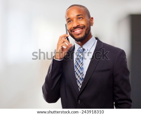 young cool black man speaking on phone - stock photo