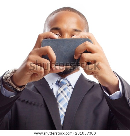 young cool black man taking a photo with his phone - stock photo