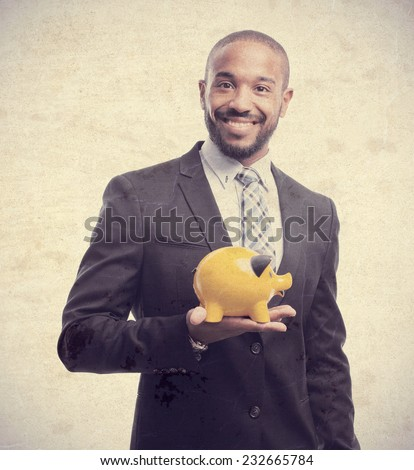 young cool black man with piggy bank - stock photo
