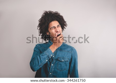 young cool black man yawning - stock photo