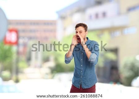 young cool man shouting - stock photo