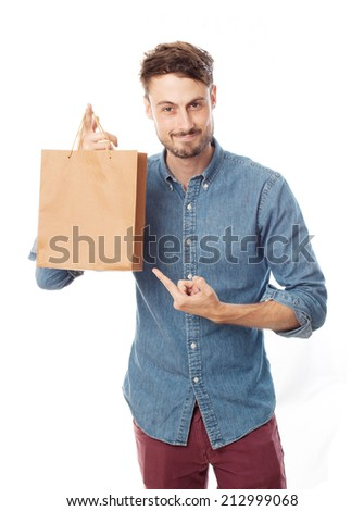 young cool man with the paper bag - stock photo