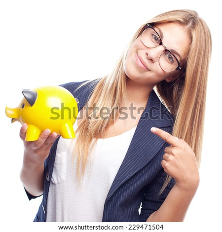 young cool woman with a piggy bank - stock photo