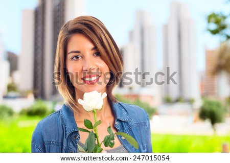 young cool woman with a rose - stock photo