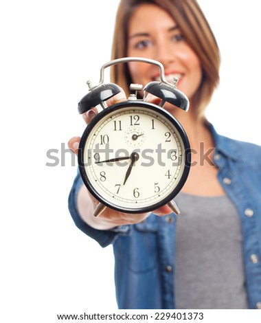 young cool woman with alarm clock