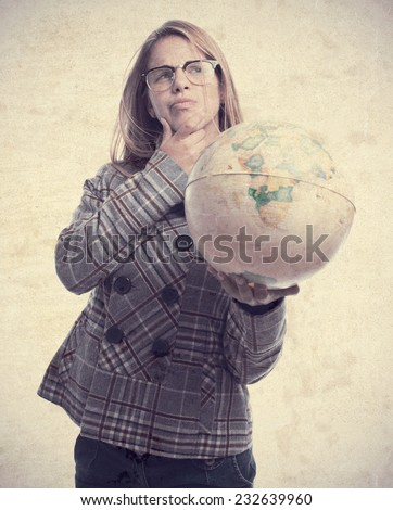 young cool woman with world globe - stock photo