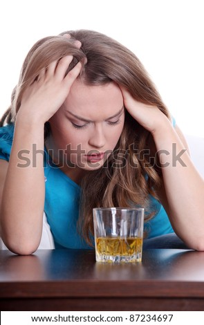 Young corpulent woman in depression, drinking alcohol - stock photo