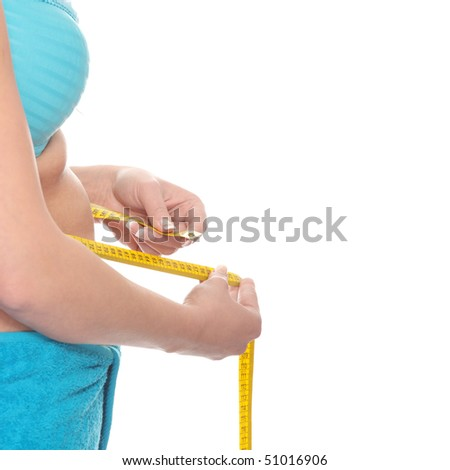 Young corpulent woman with measure tape isolated on white