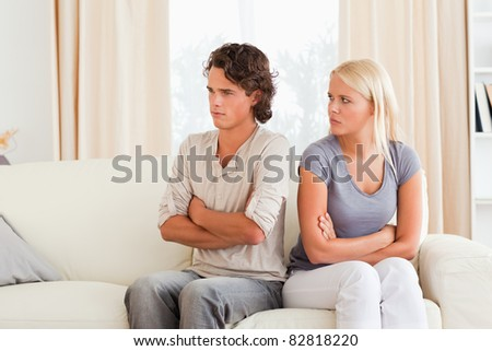 Young couple after an argument with the arms crossed - stock photo