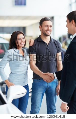 Young couple and the seller - stock photo