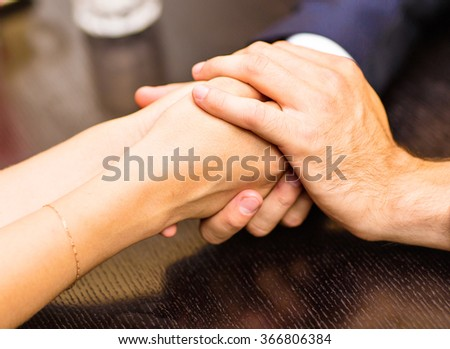 Young couple are holding hands   - stock photo