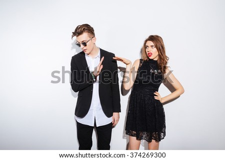 Young couple arguing isolated on a white background - stock photo