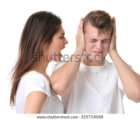 Young couple arguing with each other woman shouting yelling at her boyfriend isolated on a white background