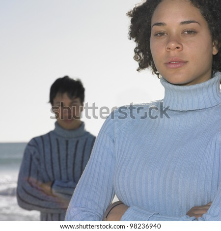 Young couple at beach - stock photo