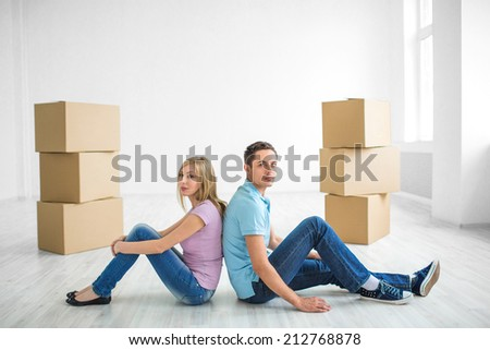 Young couple at home with boxes