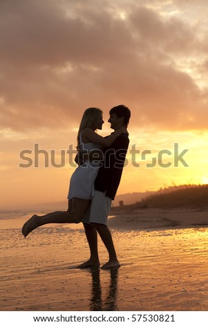 Young Couple at Sunset - stock photo