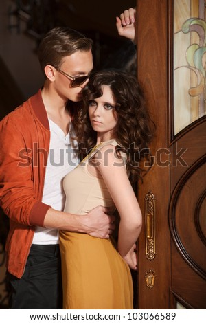 Young couple at the door