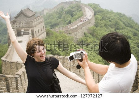 Young couple at the Great Wall of China.