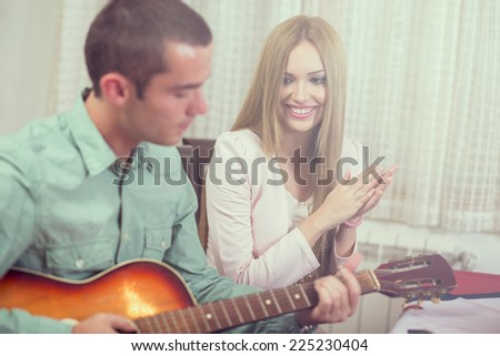 Young couple at the house party - stock photo