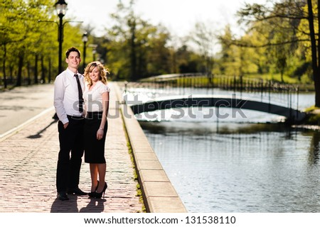 Young couple at the park - stock photo