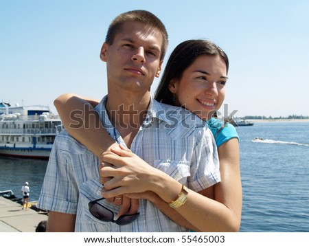 Young couple at the river port