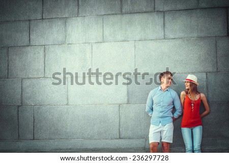 Young couple at the wall - stock photo