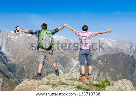 Young Couple at Top of the Mountain - stock photo