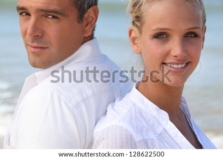 Young couple back to back - stock photo