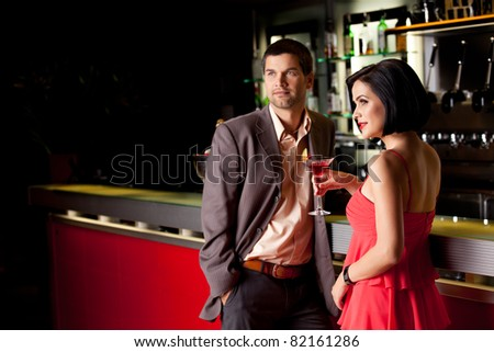young couple bar counter having drinks - stock photo
