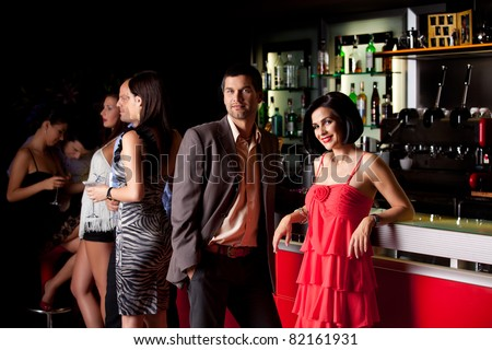 young couple bar counter having fun smiling - stock photo