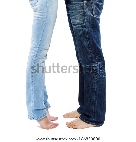 Young couple barefoot legs wearing blue jeans isolated on white background - stock photo