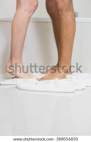 Young couple bathing together in bathtub in bathroom