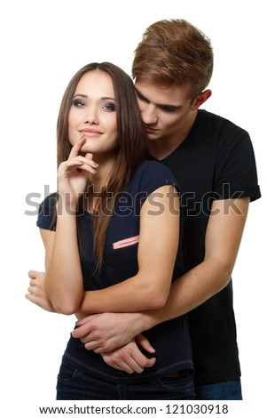 young couple, beautiful cheerful girl and boy, studio shot over white - stock photo