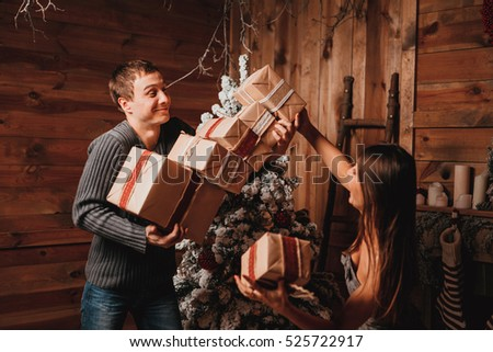 Young couple celebrating Christmas. Holiday love story.