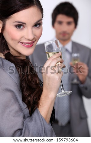 young couple celebrating event with champagne - stock photo