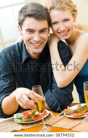 Young couple celebrating with champagne at home - stock photo