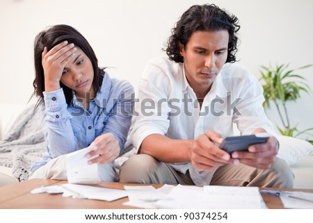 Young couple checking bills - stock photo