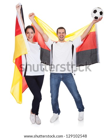 Young couple cheering for Germany. Isolated on white - stock photo