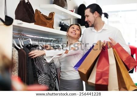 People,Beauty,Black Hair,Bonding,Boutique,Bright Colour,Carrying,Clothes Shop,Coathanger,Colour Image,Consumerism,Couple - Relationship,Customer,Cute