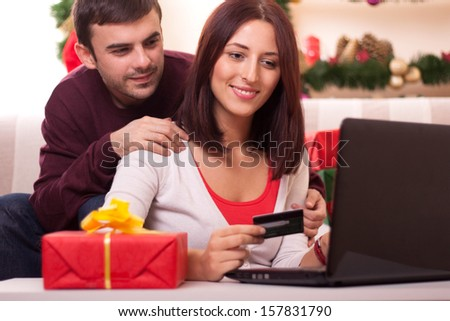 Young  couple Christmas shopping online - stock photo